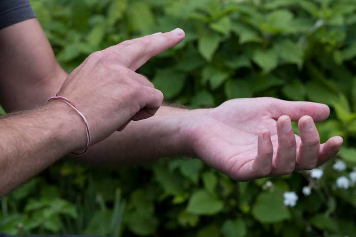 close-up-of-hands-touching-eft-tapping-therapy-tec-TUXALYR